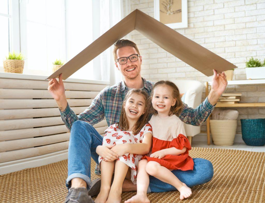 Father and children with a symbol of roof.